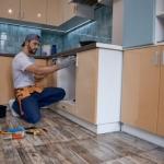 cabinet installer at work
