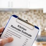 kitchen designer holding estimate on clipboard