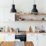 white kitchen with white subway tiles open shelving